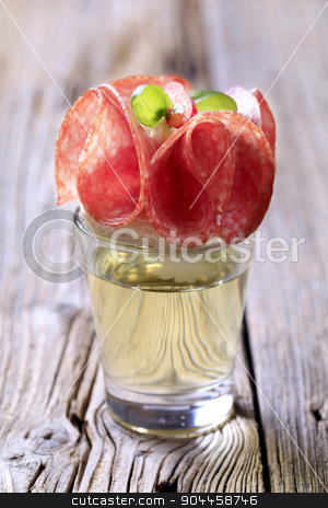 Appetizer stock photo, Salami canape on a glass of liquor by Digifoodstock