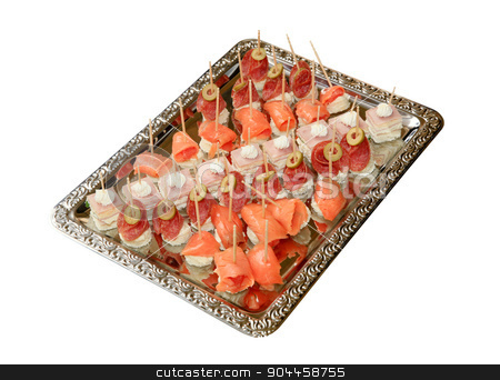 Bite-sized canapes stock photo, Variety of bite-sized canapes on a tray by Digifoodstock