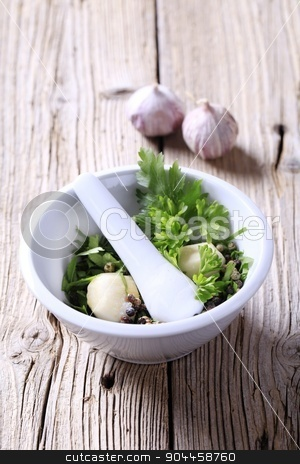 Mortar and pestle with ingredients  stock photo, Mortar and pestle with ingredients ready to be ground by Digifoodstock