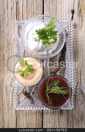 Dipping sauces stock photo, Selection of three dipping sauces on a tray by Digifoodstock