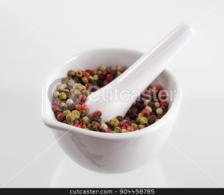Mixed peppercorns in a mortar stock photo, Mix of peppercorns in a porcelain mortar  by Digifoodstock