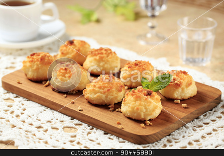 Coconut macaroons stock photo, Coconut macaroons on cutting board by Digifoodstock