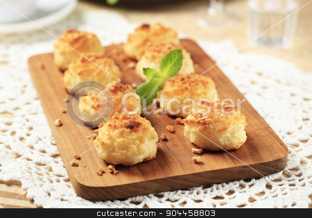 Coconut macaroons stock photo, Coconut macaroons sprinkled with chopped nuts by Digifoodstock