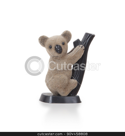 Koala figurine on a branch stock photo, Koala figurine on a branch with white background by michaklootwijk