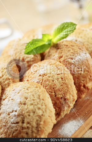Crispy cookies stock photo, Rows of crispy cookies on a cutting board by Digifoodstock