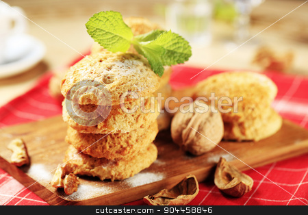 Crispy cookies stock photo, Crispy cookies on a cutting board - closeup by Digifoodstock