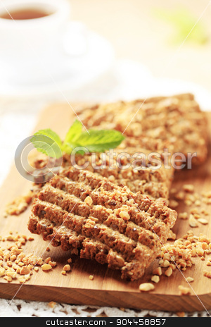Nut and seed cookies stock photo, Nutty cookies on a cutting board by Digifoodstock