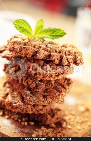 Nut and seed cookies stock photo, Stack of wholegrain nutty cookies - detail by Digifoodstock