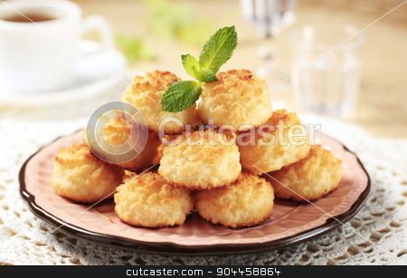 Coconut macaroons stock photo, Stack of coconut macaroons on a decorative plate by Digifoodstock