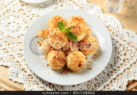 Coconut macaroons stock photo, Stack of coconut macaroons on a plate by Digifoodstock