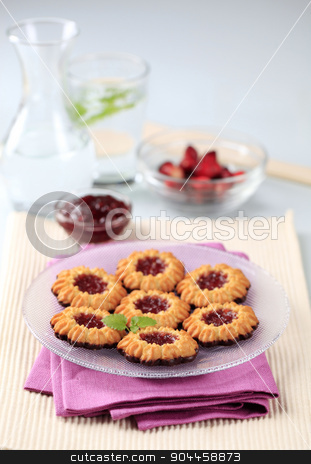 Jam cookies stock photo, Chocolate dipped butter cookies with jam centers by Digifoodstock