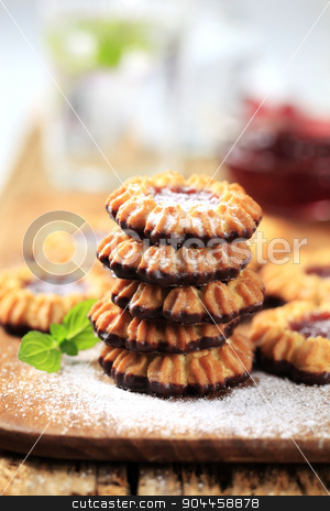 Jelly cookies stock photo, Chocolate dipped cookies with jelly center by Digifoodstock