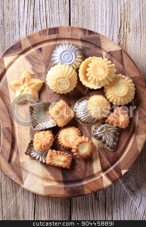 Tart shells and baking pans stock photo, Variety of tart shells and baking pans by Digifoodstock