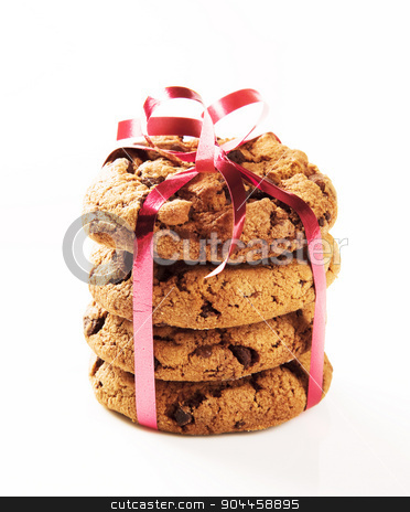 Chocolate chip cookies  stock photo, Chocolate chip cookies tied with a red ribbon  by Digifoodstock