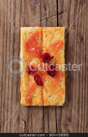 Crispbread with jam stock photo, Crispbread and jam topped with dried cranberries by Digifoodstock
