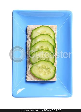 Crisp bread with fresh cucumber stock photo, Crisp bread with slices of fresh cucumber by Digifoodstock