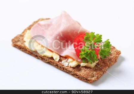 Brown crisp bread with ham stock photo, Whole grain crisp bread with ham by Digifoodstock