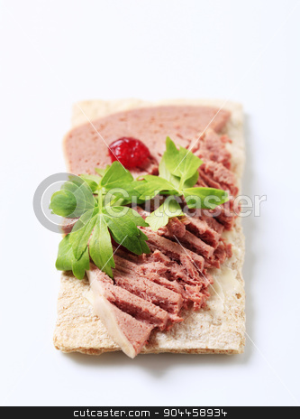 Crispbread and liver pate  stock photo, Crispbread with butter and liver pate by Digifoodstock