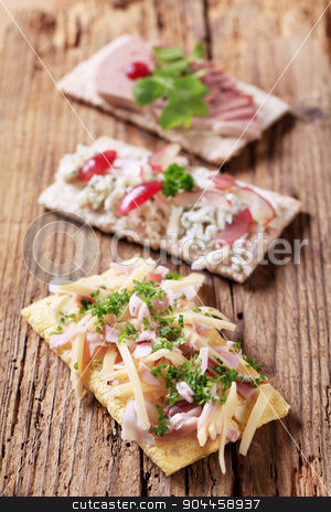 Crispbread with various toppings stock photo, Three slices of crispbread with various toppings by Digifoodstock
