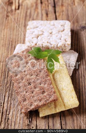 Various types of crisp bread stock photo, Various types of crisp bread on wood by Digifoodstock