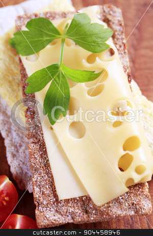 Crisp bread and cheese stock photo, Variety of crispbread and a slice of Swiss cheese by Digifoodstock