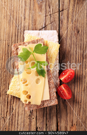 Crispbread and cheese stock photo, Various types of crispbread and slice of Emmentaler cheese by Digifoodstock