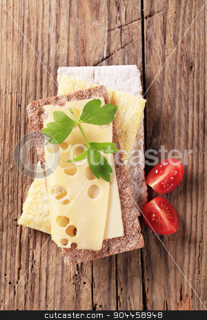 Crispbread and cheese stock photo, Variety of crispbread and a slice of Swiss cheese by Digifoodstock