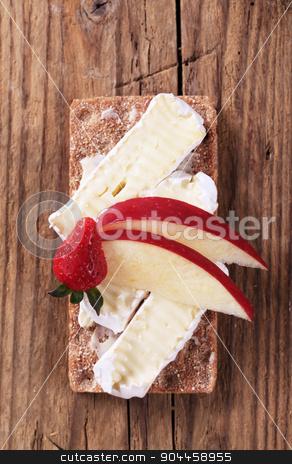 Crispbread and cheese stock photo, Whole grain rye crispbread and cheese by Digifoodstock