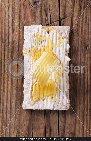 Crispbread with butter and honey or maple syrup stock photo, Slice of crispbread,with butter and honey or maple syrup by Digifoodstock