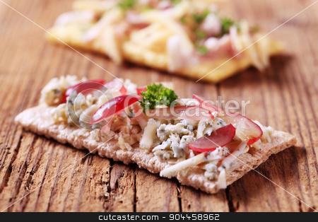 Crispbread and blue cheese  stock photo, Crispbread and blue cheese topping - closeup by Digifoodstock