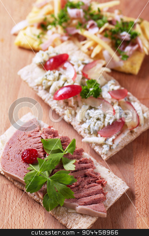 Crispbread with various savory toppings stock photo, Crisp bread with various savory toppings by Digifoodstock
