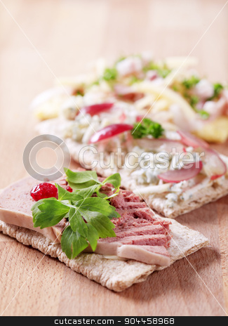 Crispbread with various toppings stock photo, Crispbread with various toppings - closeup by Digifoodstock