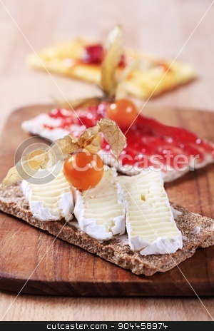 Crispbread with cheese and jam stock photo, Crisp bread with cheese and jam by Digifoodstock