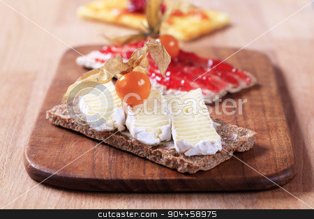 Crisp bread with cheese and jam stock photo, Variety of crisp bread with cheese and jam by Digifoodstock