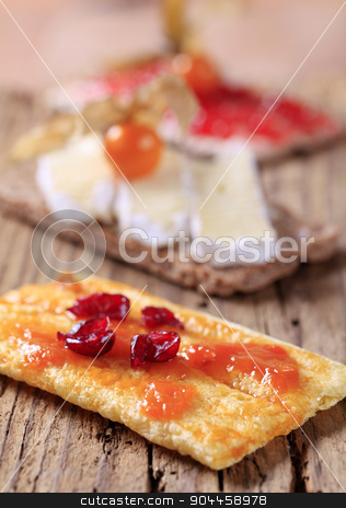 Crispbread with marmalade, cheese and jam stock photo, Slices of crisp bread with marmalade, cheese and jam by Digifoodstock