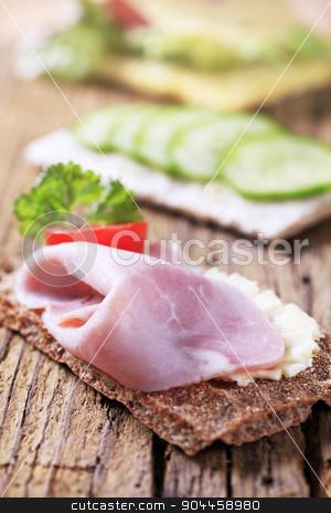 Crisp bread with ham stock photo, Whole grain crispbread with ham  by Digifoodstock