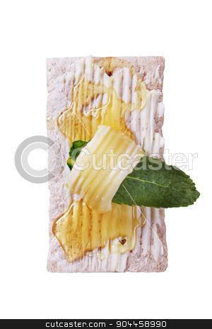 Crispbread and honey stock photo, Slice of crispbread, butter and honey - overhead by Digifoodstock