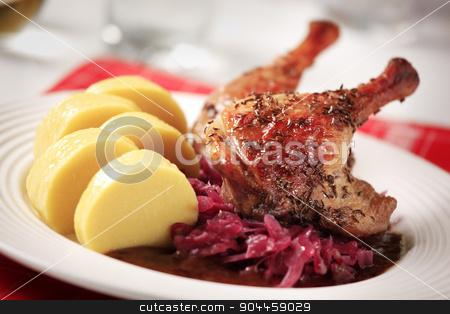 Roast duck, red cabbage and potato dumplings stock photo, Roast Duck Legs with Red Cabbage and  Potato Dumplings by Digifoodstock