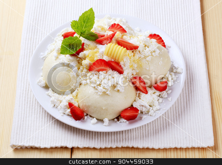 Fruit dumplings stock photo, Fruit dumplings served with cottage cheese, sugar, butter and strawberries by Digifoodstock