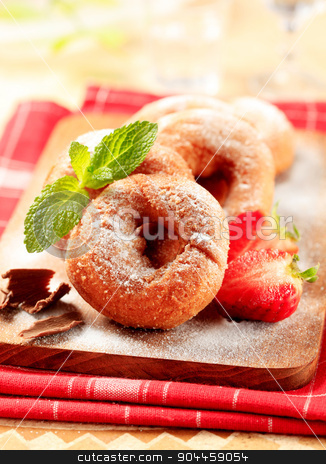 Ring doughnuts stock photo, Ring doughnuts sprinkled with icing sugar by Digifoodstock