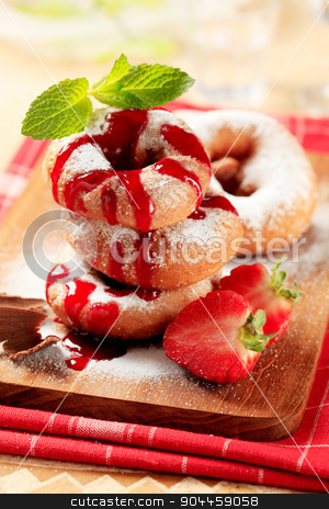 Ring donuts  stock photo, Ring donuts with strawberry syrup by Digifoodstock
