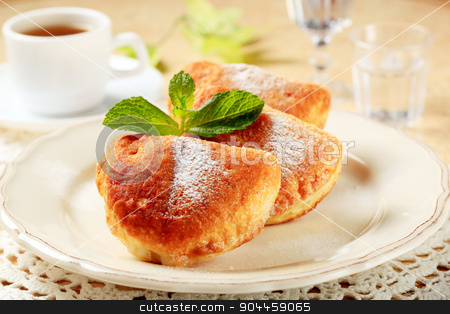 Jam filled puff pastry donuts stock photo, Puff pastry donuts and a cup of tea by Digifoodstock