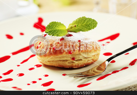 Donut stock photo, Jam filled donut powdered with icing sugar  by Digifoodstock