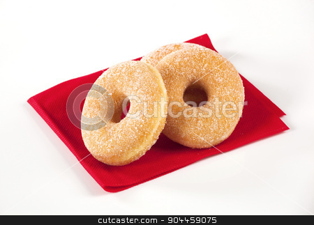 Donuts stock photo, Donuts sprinkled with powdered sugar by Digifoodstock