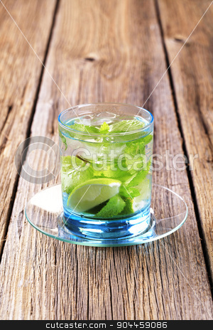 Glass of Mojito stock photo, Glass of Mojito drink with ice by Digifoodstock