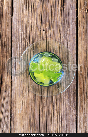 Glass of Mojito stock photo, Glass of Mojito drink with ice - overhead by Digifoodstock