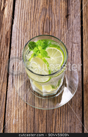 Glass of cold drink stock photo, Glass of cold drink with slices of lime by Digifoodstock