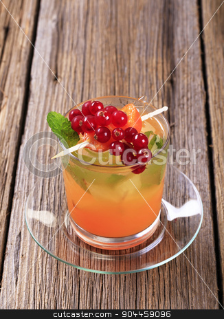 Glass of iced drink stock photo, Glass of iced drink garnished with fresh fruit by Digifoodstock