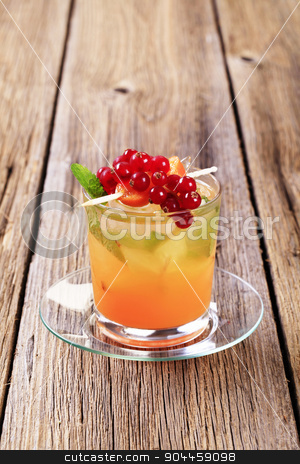 Iced drink stock photo, Glass of iced drink garnished with fresh fruit by Digifoodstock