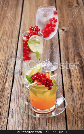 Summer drinks stock photo, Glasses of iced drinks garnished with fresh fruit by Digifoodstock